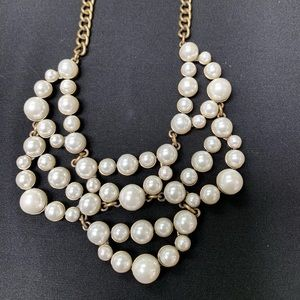 Antiqued gold and pearl statement necklace